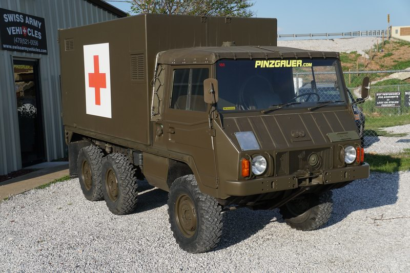 Swiss Army Troop Carrier with 2 rear Bench Seats   ..